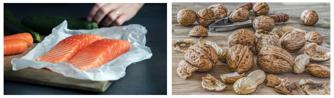 Examples of foods high in polyunsaturated fats are shown. On the right is a photo of two raw salmon fillets and on the left is a wooden board with a variety of nuts still in their shell and a handheld nutcracker.