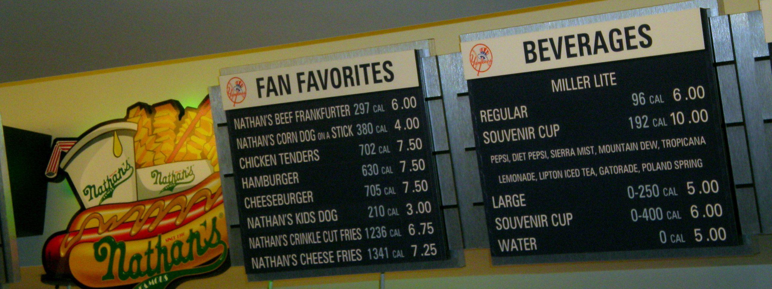 A menu sign at a Nathan's hotdog stand displays calorie countrs
