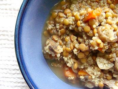 A bowl of lentils and quinoa.