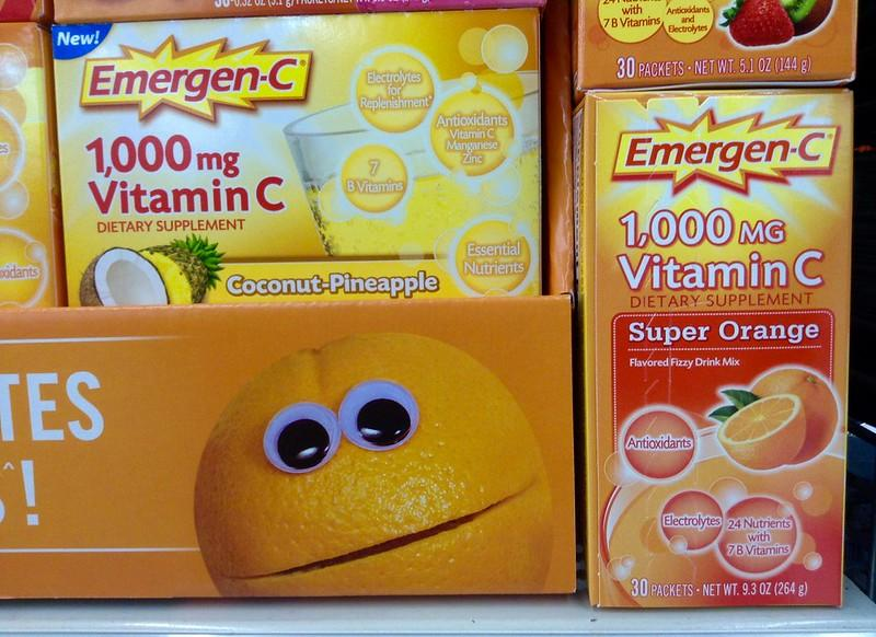 A photograph shows several boxes of Emergen-C dietary supplement, labeled with flavors like super orange and coconut-pineapple and in doses of 1,000 mg of vitamin C.